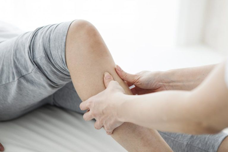 Person having their leg massage to treat MS pain