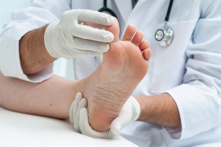 doctor inspecting a foot